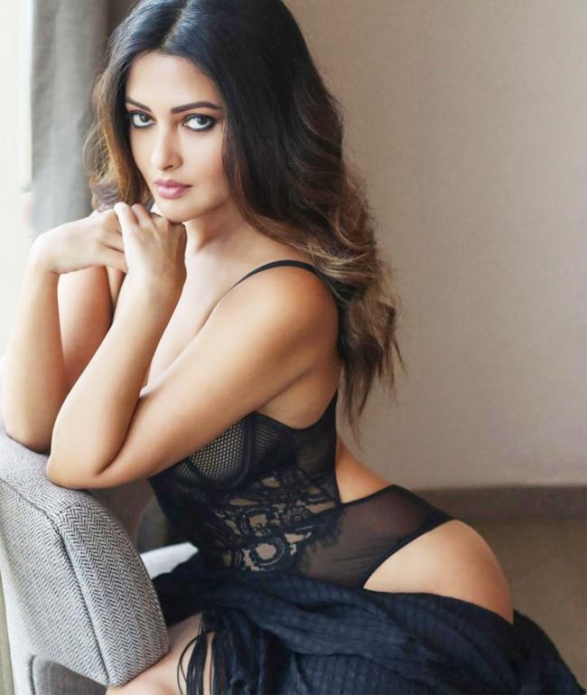 Riya Sen Flaunts Her Curves In Net Black Bikini