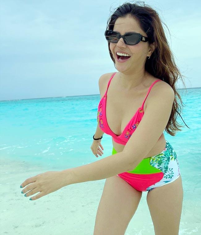 Rubina Dilaik in a sexy neon swimsuit