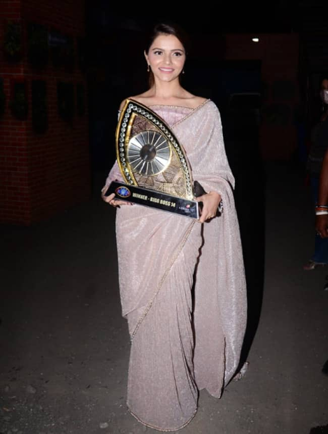 Rubina Dilaik poses with the trophy in a sparkly saree