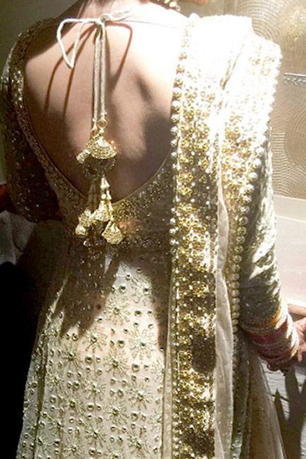 Sambhavna Seth showing off her sexy back in her wedding reception dress