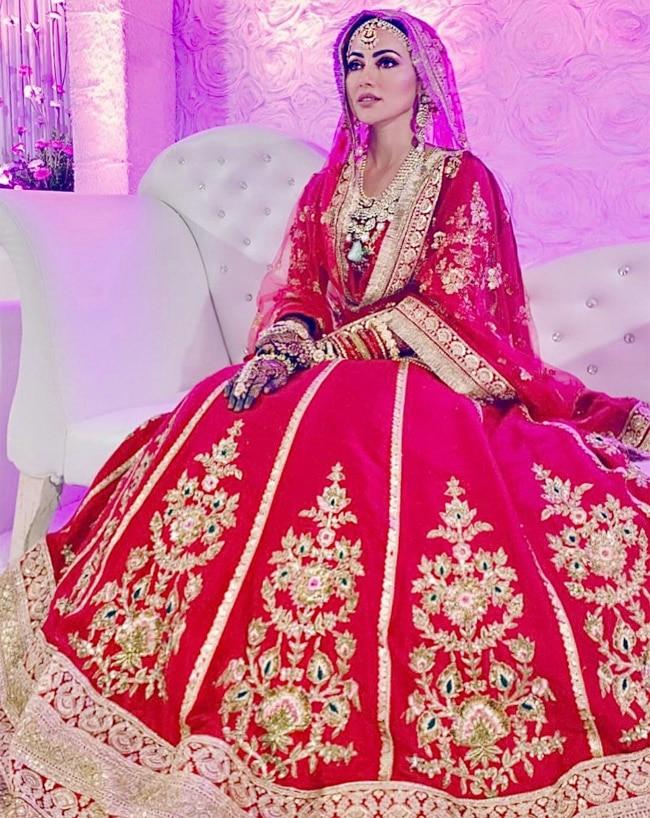 Sana   s red lehenga by Poonams Kaurture featured dupian crepe and gotha borders