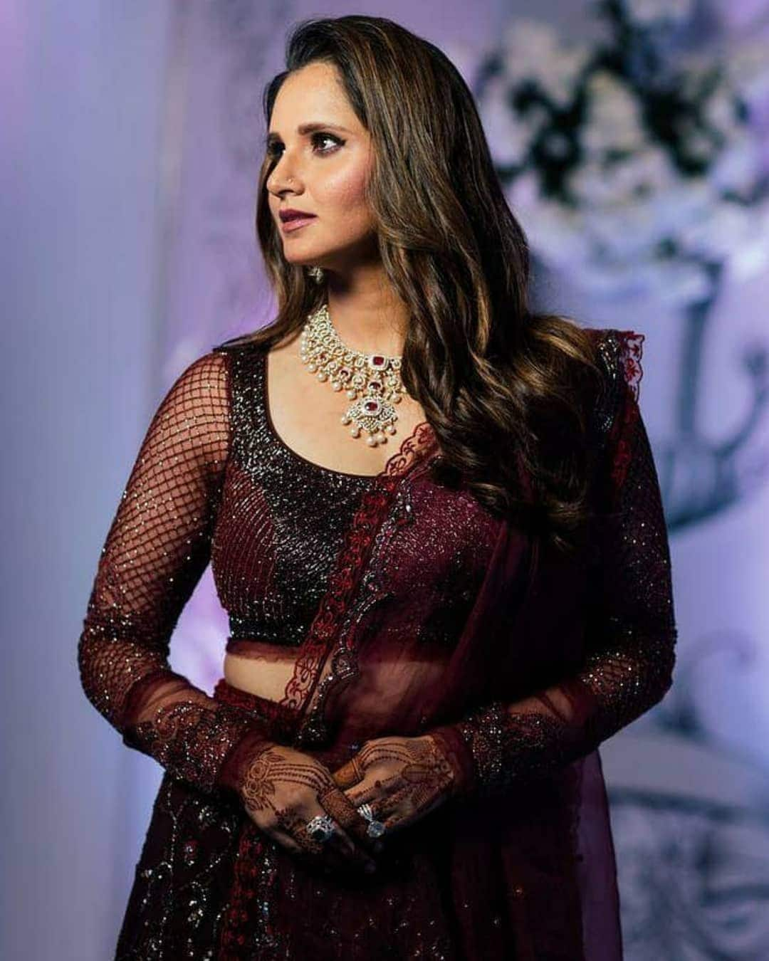 Sania Mirza Dazzles in this Dark Maroon Dress