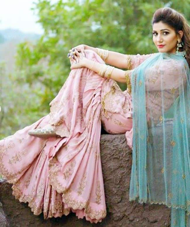 Sapna Choudhary Looks Jaw dropping Gorgeous in Heavy Embellishment Pink Sharara And Bold Red Lips