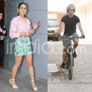 Sara Ali Khan Glows in Pink While Ishaan Khatter Rides Bike on Mumbai Roads Wearing Headphones