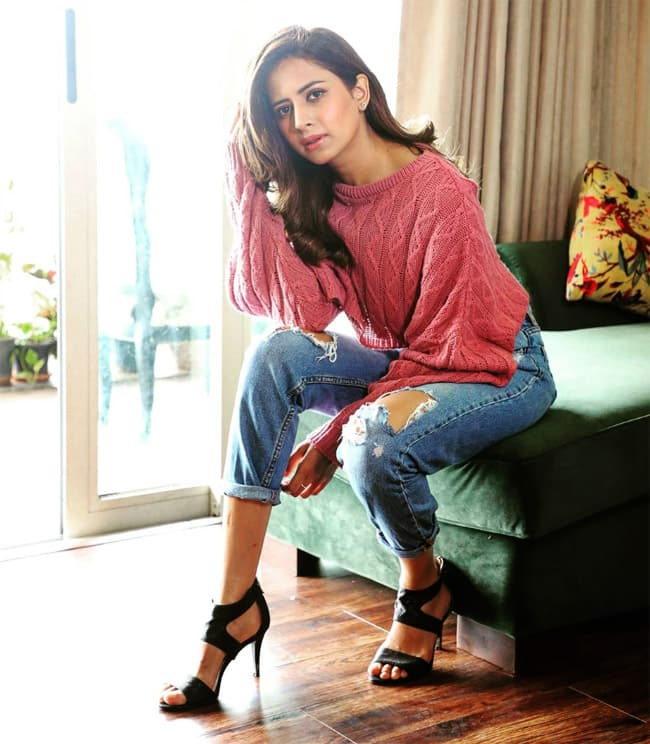 Sargun Mehta looks fresh wearing a floral white shirt with high waist pair of denim