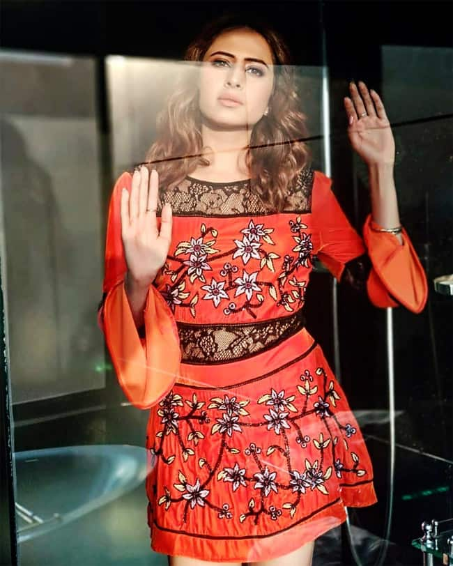Sargun Mehta Poses in Little Orange Dress  Looks Smoking Hot