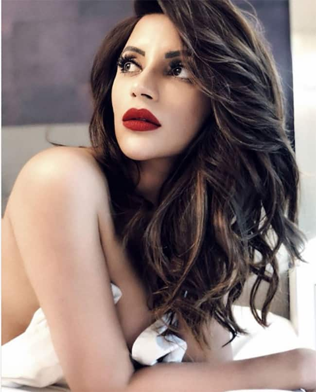 Shama Sikander poses sea side during in a sexy attire | newsdezire