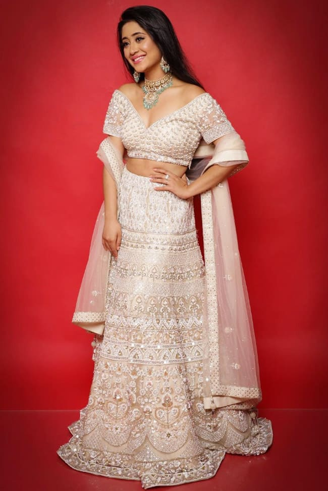 Shivangi Joshi looks elegant in a white heavy embroidered lehenga choli set