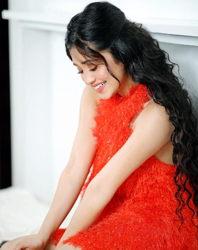 Shivangi Joshi wears an orange dress