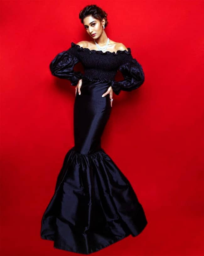 Sizzling Erica in a fishtail gown