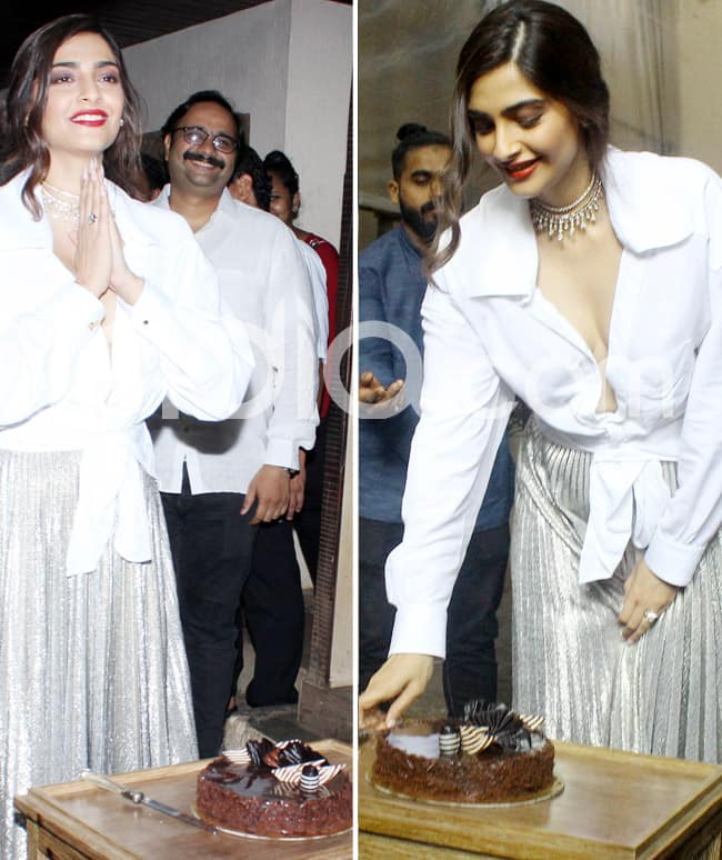 Sonam cuts cake for the paps