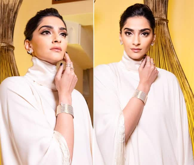 Sonam Kapoor looks stunning in an ivory fringed kaftan dress