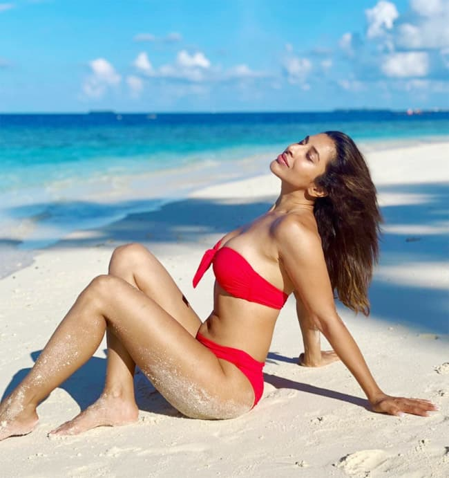 Sophie Choudry sizzles in a red bikini amid white sand