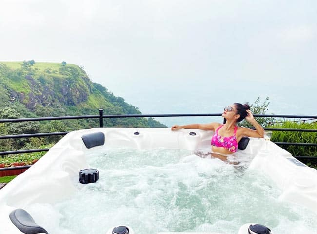 Sreejita De soaks in a hot water tub