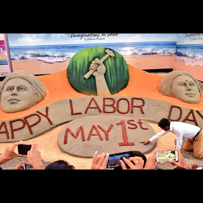 Sudarsan Pattnaik   s sand art on Labour Day 2017