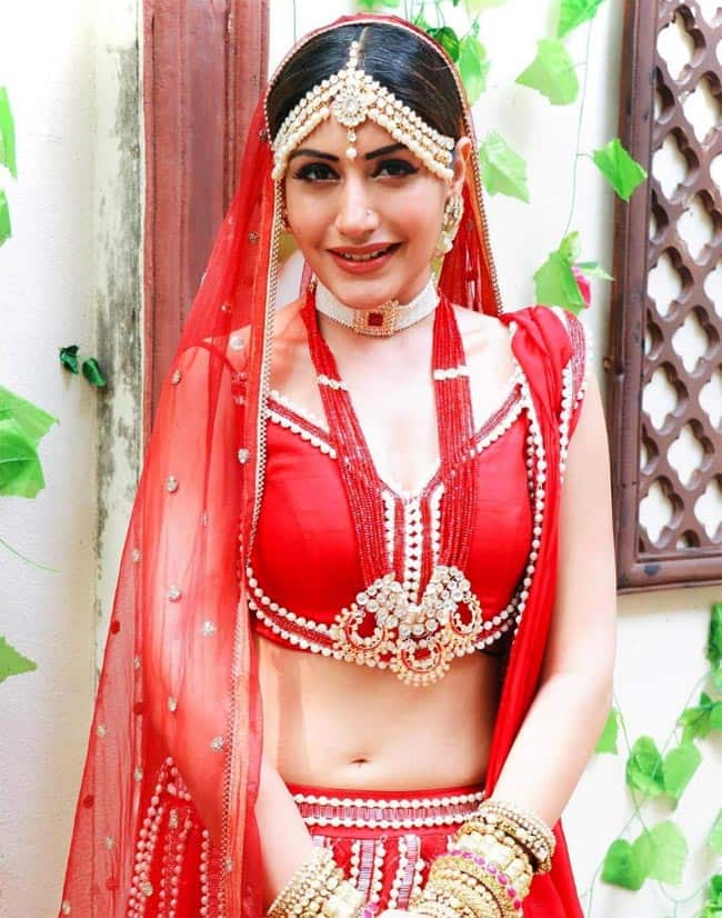 Surbhi Chandna wears a red bridal lehenga in new pics from Naagin 5