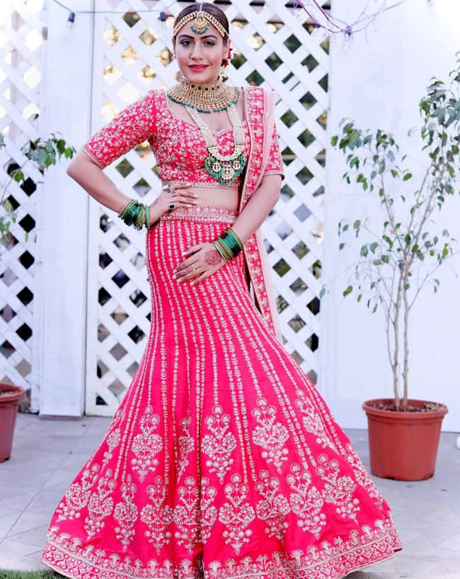 Surbhi Chandna Strikes Dabang Dulhan Pose In Gorgeous Bridal Lehenga Check Out Her Sultry Pictures