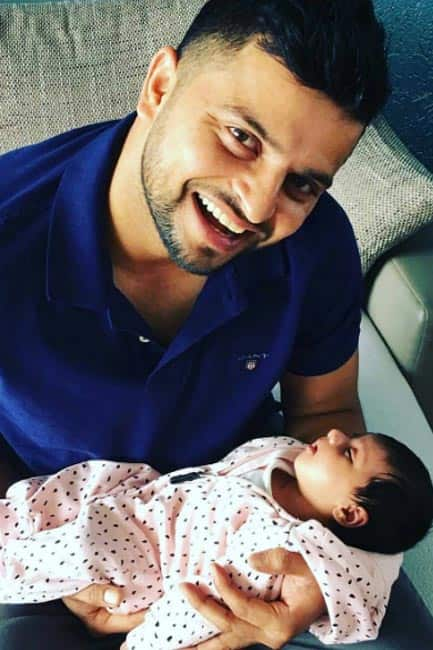 Suresh Raina clicked with his newborn daughter