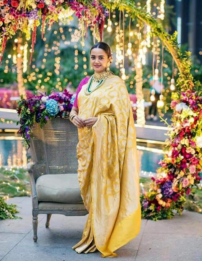 Surveen Chawla looks beautiful in a yellow golden saree