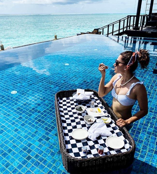 Taapsee Pannu can be seen enjoying her breakfast in white bikini