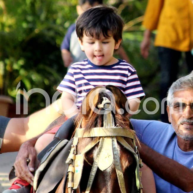 Taimur cutely sticks his tongue out