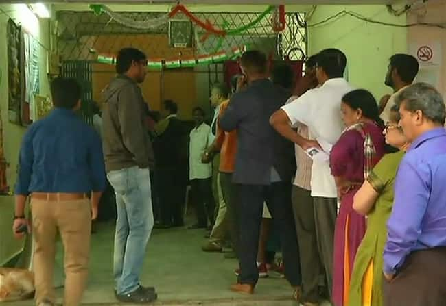 Telangana People queue outside a polling station in Jubilee Hills  Hyderabad to cast their votes Voting is being held in 119 constituencies of the state today