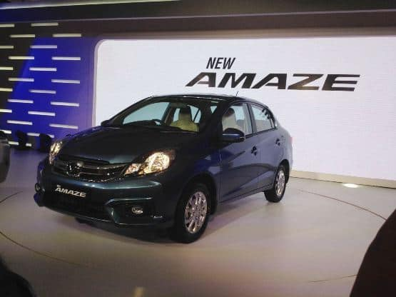 The new Honda Amaze features muscular front bumper with integrated fog lamps  amp  a dual slat chrome grille that houses the Honda insignia  The car gets halogen headlamps and wider air dam that gives the car a wider stance