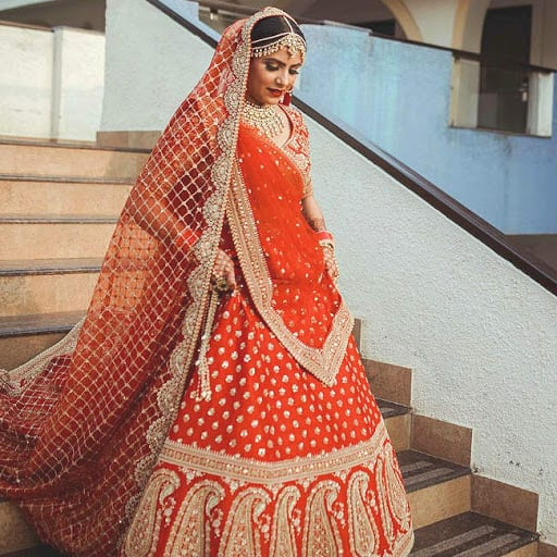 The smiling Sabyasachi bride in red