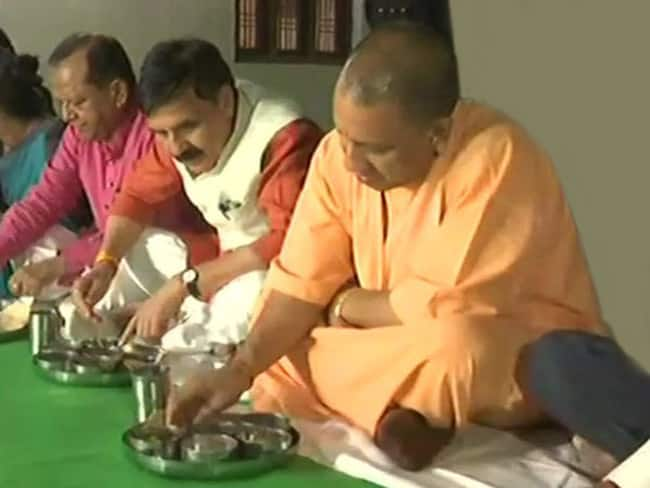 UP CM Yogi Adityanath visits a Dalit family in Madhupur