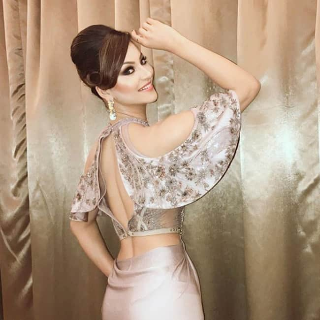 Urvashi Rautela flaunting her back in sexy outfit