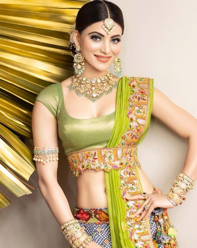 Urvashi Rautela looks stunning in her bandhani lehenga with sexy blouse