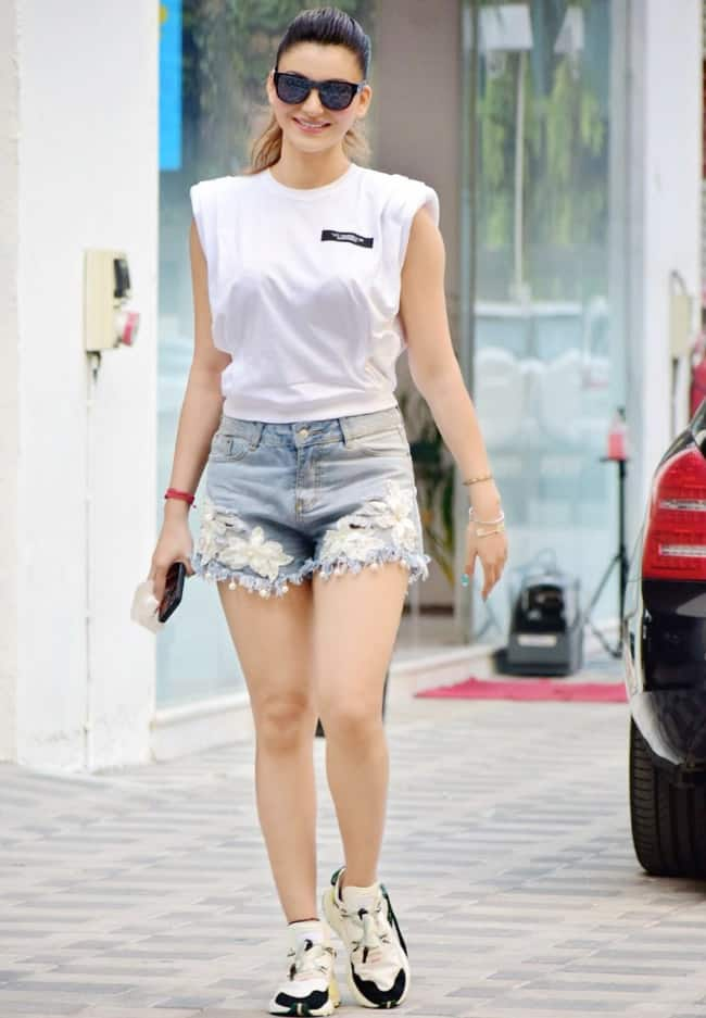 Urvashi Rautela pairs her denim shorts with a white crop top