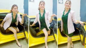 Urvashi Rautela Stuns Her Fans In Little Green Dress As She Struggles To Get Out Of Her 'Bae Lambo',