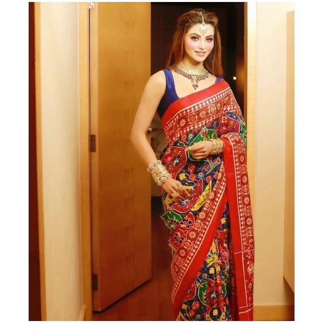 Urvashi Rautela wears her Patola saree with heavy gold jewellery