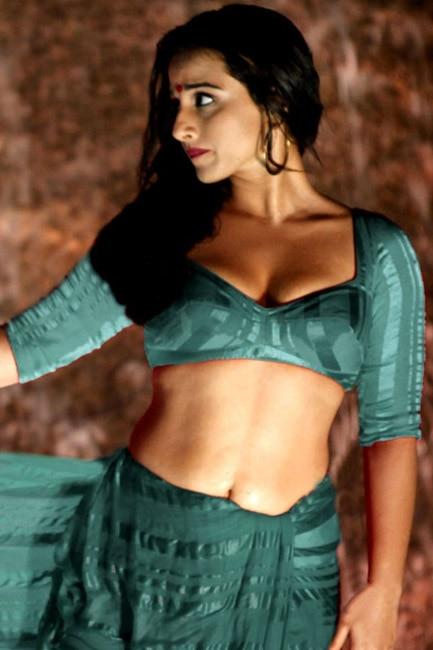 Vidya Balan flaunting her mid riff in hot shoot