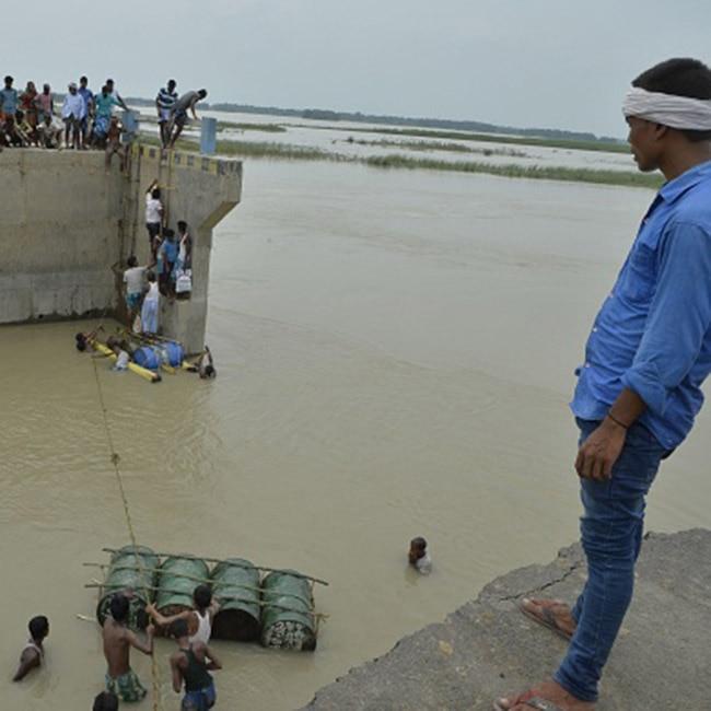 Villagers crossing flood waters in Bihar