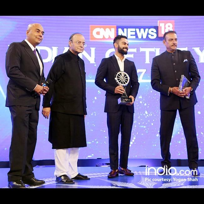 Virat Kohli receiving the Jio popular choice Indian of the year award