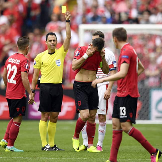 Yellow card shown by referee to Albania   s captain Lorik Cana in UEFA Euro 2016 Group A match